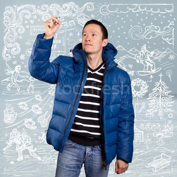 Asia hombre abajo abrigo azul invierno Foto stock © leedsn