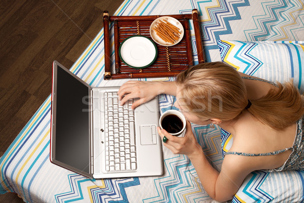 Stock photo: woman in bed with laptop