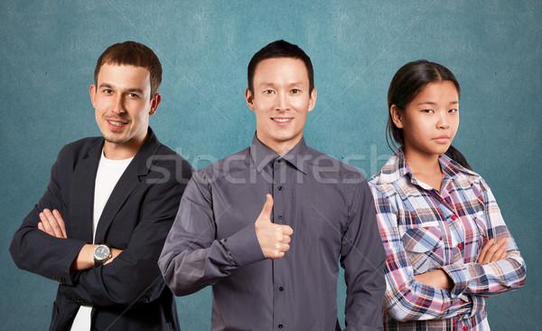 Stockfoto: Asian · team · zakenman · pak · man · gevouwen