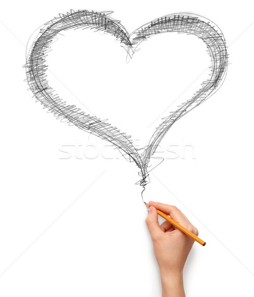 heart and hand with pencil Stock photo © leedsn