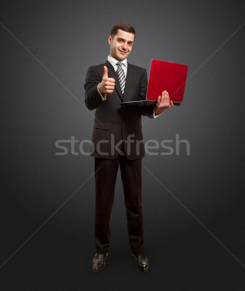 businessman with laptop shows well done Stock photo © leedsn