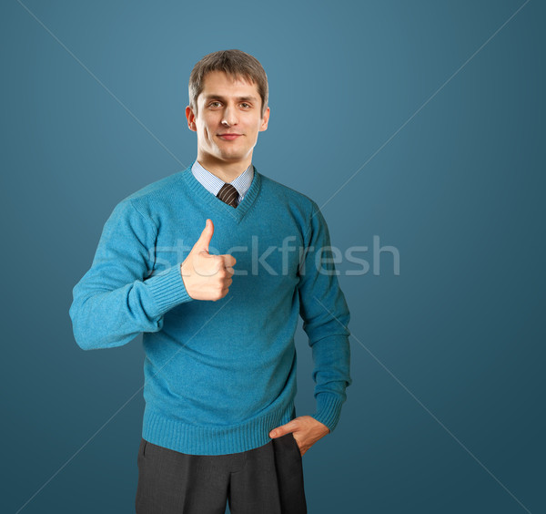 man in blue shows well done Stock photo © leedsn