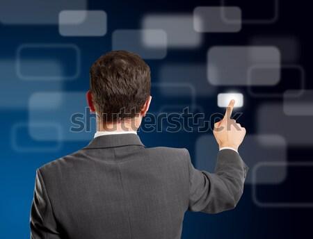 Business Man Push the Button Stock photo © leedsn