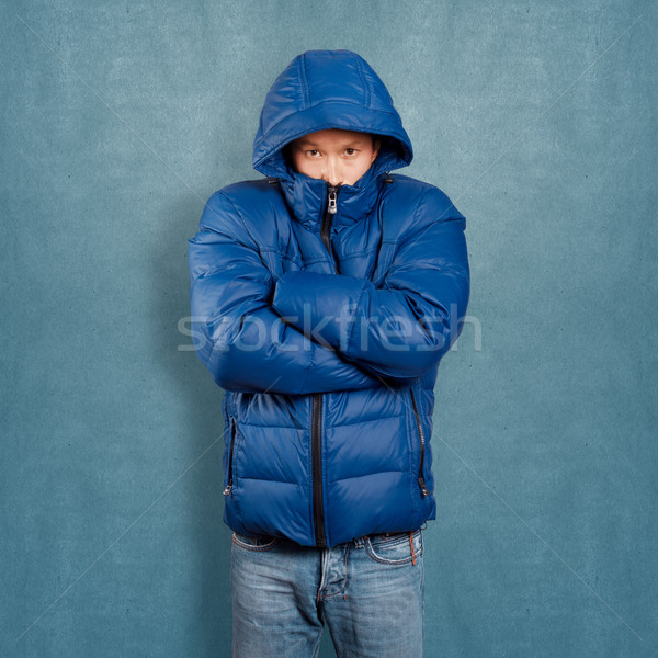 Asian homme vers le bas manteau bleu visage Photo stock © leedsn