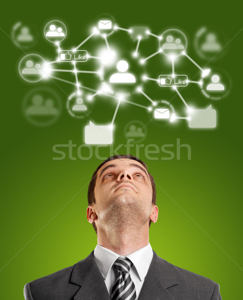 Businessman Looking Upwards in Social Network Stock photo © leedsn