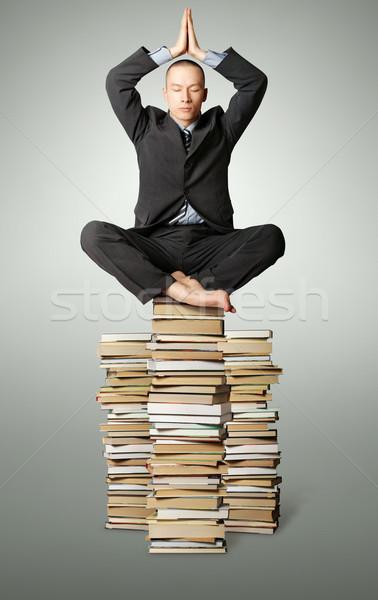 Stok fotoğraf: Işadamı · lotus · poz · çok · kitaplar · yalıtılmış