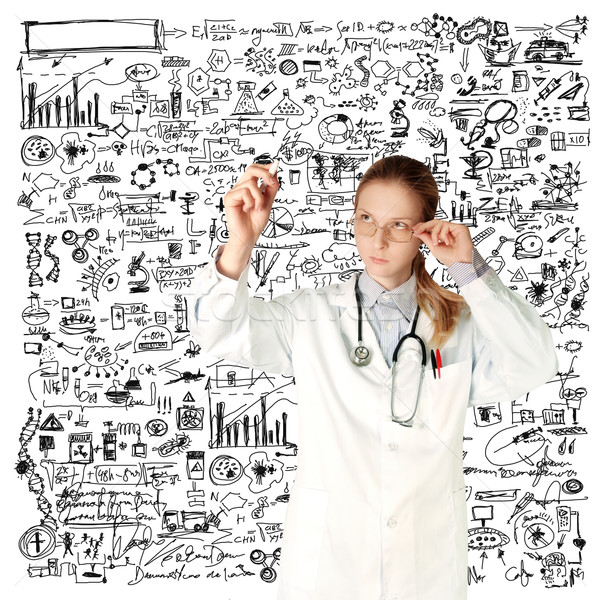 doctor woman writting something Stock photo © leedsn