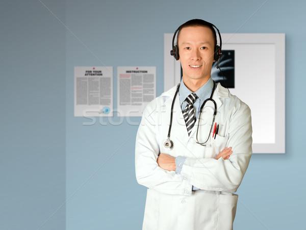 Orvos fejhallgató ázsiai laborköpeny sztetoszkóp egészség Stock fotó © leedsn