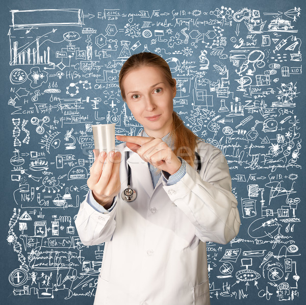 Doctor woman with cup for analysis Stock photo © leedsn