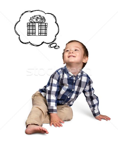 Cute boy siting on the floor Stock photo © leedsn