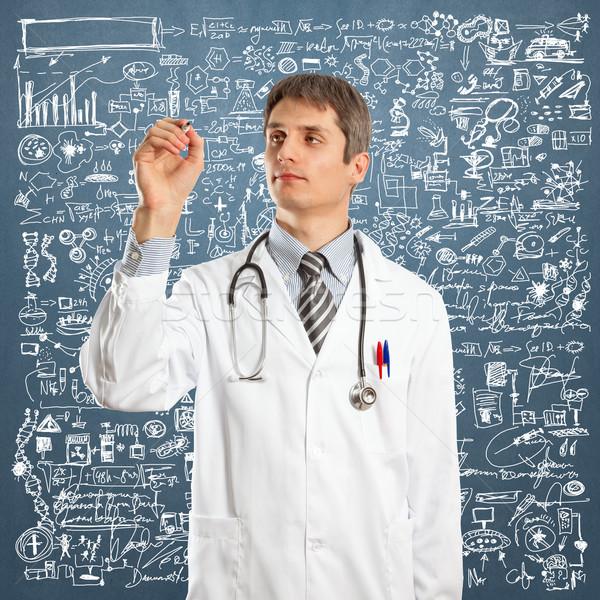 Doctor Male Writing Something Stock photo © leedsn