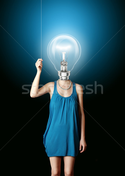 blonde in blue turn on the bulbhead Stock photo © leedsn