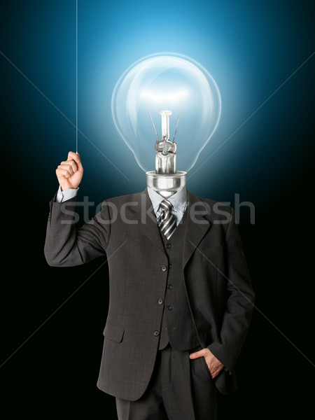 business man turn on hith bulb head Stock photo © leedsn