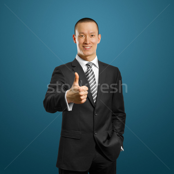 asian businessman in black suit shows well done Stock photo © leedsn
