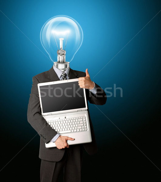 businessman with lamp-head with open laptop shows welldone Stock photo © leedsn