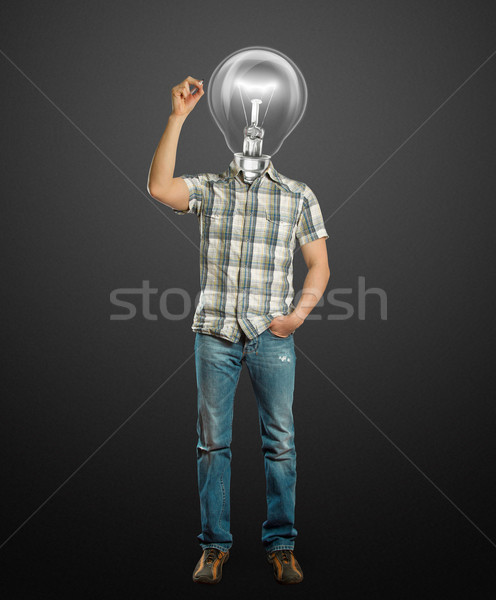 Stock photo: asian male with lamp writting something
