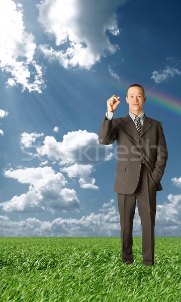 asian businessman writting something outdoors Stock photo © leedsn