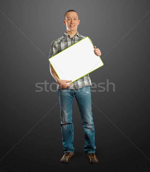 asian male with write board in his hands Stock photo © leedsn