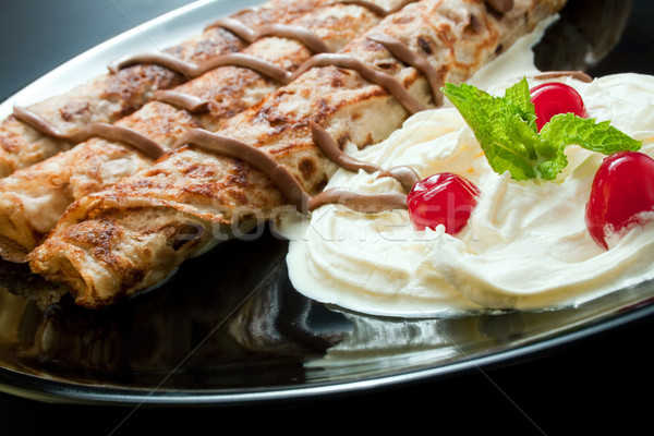 Pfannkuchen Sahne Schokolade drei gerollt Stock foto © Leftleg