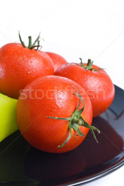Paradicsomok friss fekete kerámia tányér közelkép Stock fotó © Leftleg