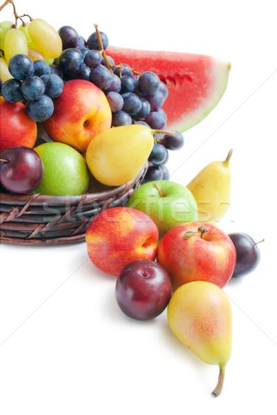 Gyümölcsök különböző friss érett fonott kosár Stock fotó © Leftleg