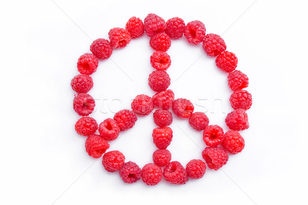 Raspberries arranged in the shape of the symbol of peace Stock photo © Leftleg