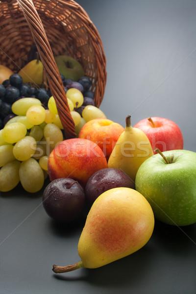 Gyümölcsök friss érett fonott kosár szürke Stock fotó © Leftleg