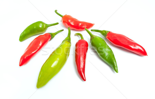Forró paprikák zöld piros izolált fehér Stock fotó © Leftleg