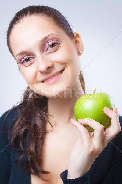beautiful young woman holding an apple Stock photo © Leftleg