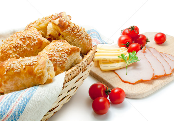 Puff pastry patties with cheese ham sesame and cherry tomatoes. Stock photo © Leftleg