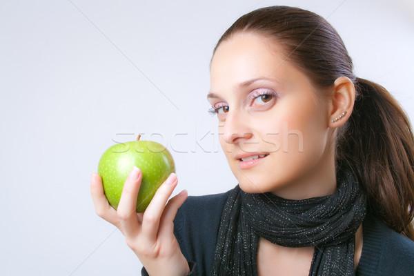 Gyönyörű fiatal nő mutat alma elegáns fiatal Stock fotó © Leftleg