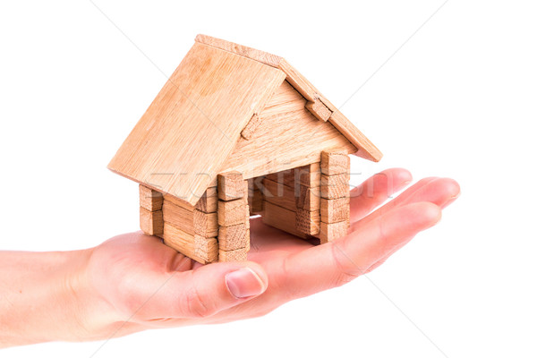 Wooden model house in a hand Stock photo © Len44ik