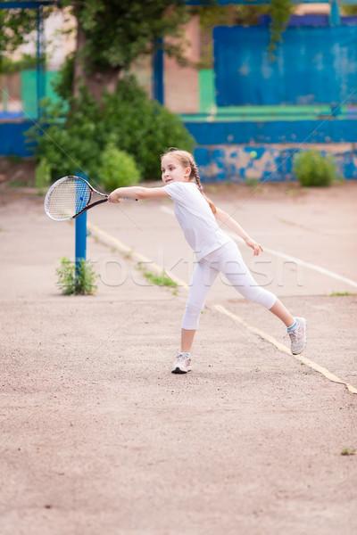 Adorable pequeño nino jugando tenis raqueta de tenis Foto stock © Len44ik