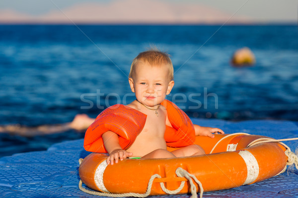 Happy baby in life-buoy on the pontoon Stock photo © Len44ik