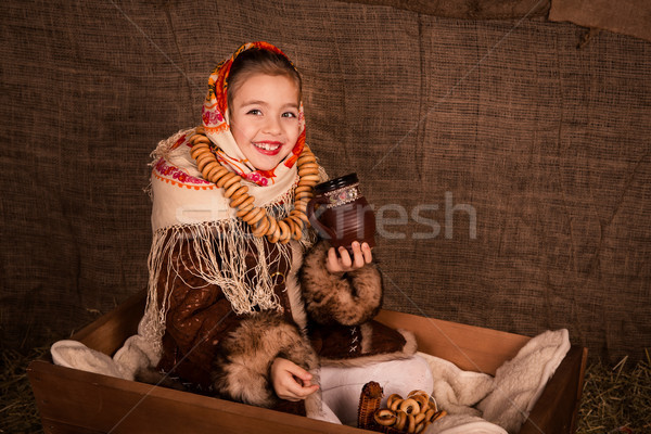 Beautiful russian girl in a shawl  sitting in a cart  Stock photo © Len44ik