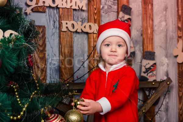 Happy little baby in Santa's costume near Xmas tree Stock photo © Len44ik