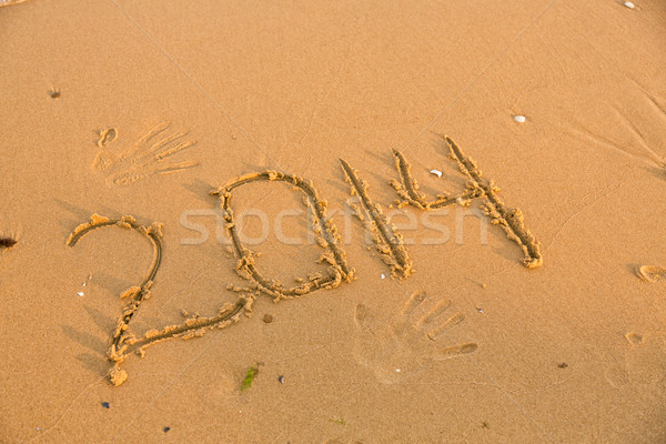 2014 numbers on the yellow sandy beach Stock photo © Len44ik