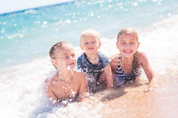 Happy kids on the beach Stock photo © Len44ik