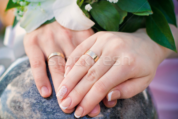 Hands of bride and groom and rings with wedding bouquet Stock photo © Len44ik