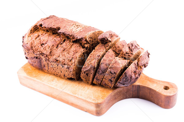 Fresh  sliced homemade whole grain brown bread with cereals on a wooden board Stock photo © Len44ik