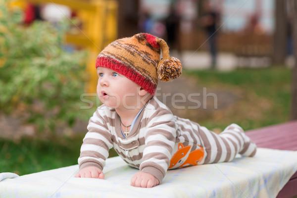 Cute little baby lying in the park Stock photo © Len44ik