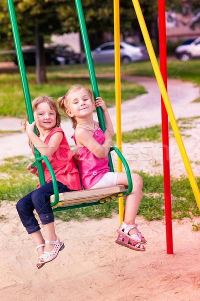 Stock fotó: Kettő · gyönyörű · kislányok · szabadtér · játszótér · nyáridő