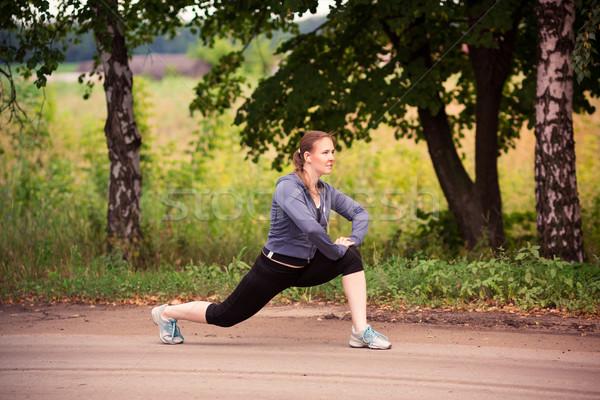 Futó nő nyújtás természet szabadtér gyönyörű Stock fotó © Len44ik