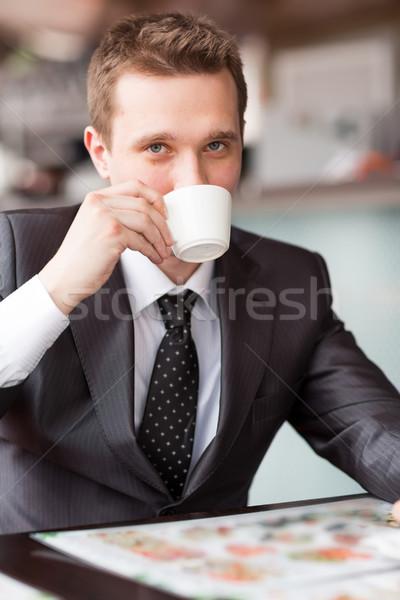 Jovem bonito empresário potável café sessão Foto stock © Len44ik