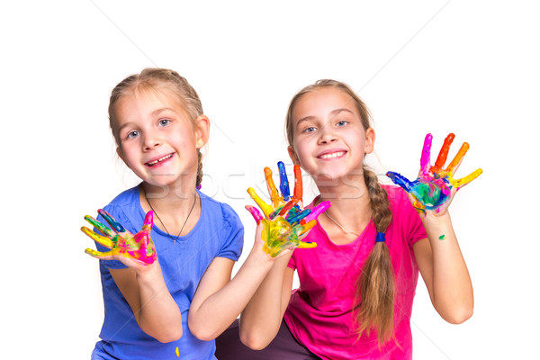 Happy girls with hands in paint Stock photo © Len44ik