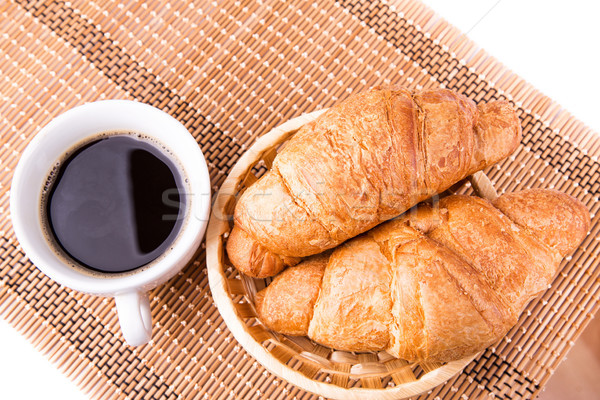 Fresh and tasty French croissants in a basket and cup of coffee served Stock photo © Len44ik