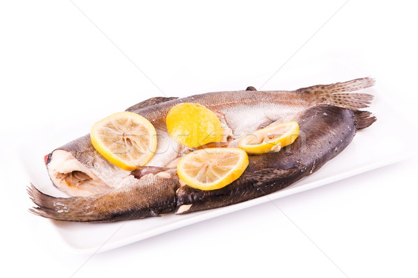 Trout with lemon cooked in a steamer. Healthy food concept. Stock photo © Len44ik