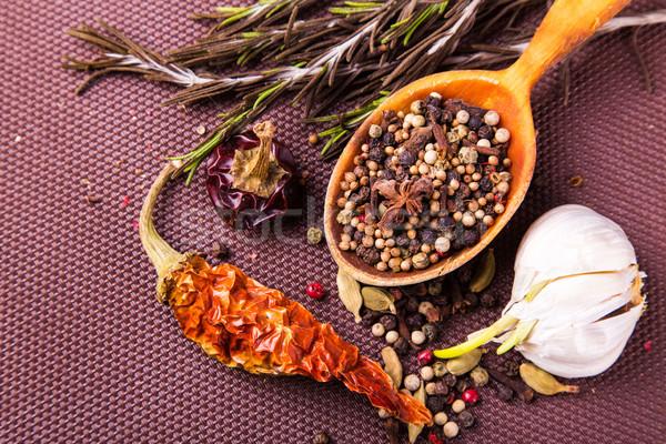 Különböző fűszer gyógynövények fakanál barna asztalterítő Stock fotó © Len44ik