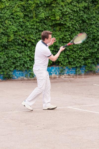 Kifejező fiatalember játszik tenisz szabadtér természet Stock fotó © Len44ik