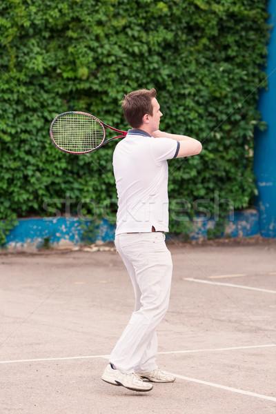 Espressiva giovane giocare tennis outdoor natura Foto d'archivio © Len44ik